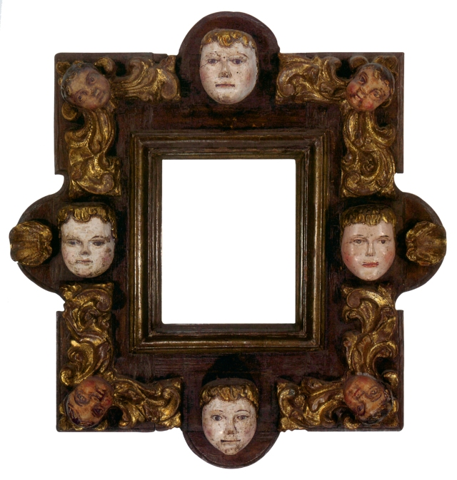 At Lowy, we're visual people, and we love faces. This small late 17th-early 18th century carved, gilt and polychrome frame contains shells and painted masks connected to cherub heads and stylized scrolling leaf carvings.
