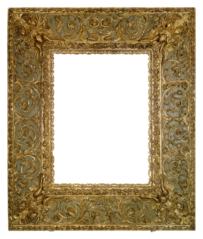A fabulous frame of reverse profile, featuring inner continuous carving of clustered fruit, panels decorated with spread-winged birds at corners connected by elaborately scrolled leaf ornament, and outer carving of a continuous-wing motif.